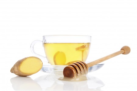 Cup of ginger tea with honey isolated.