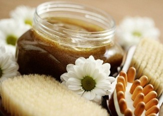 jar of body scrub and massager - beauty treatment